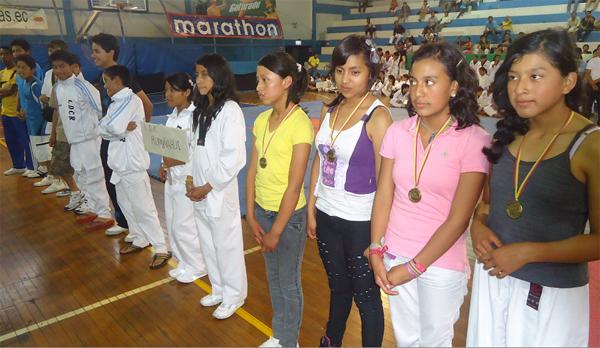 Inauguración del campeonato interbarrial de Taekwondo que auspicia Diario El Universo. Deportistas  de la Liga Deportiva Cantonal de Rumiñahui.